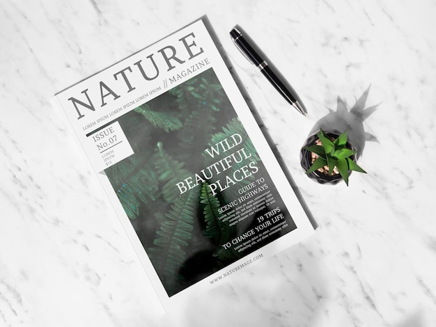 Nature magazine next to a succulent plant mock up Free Psd
