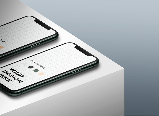 New smartphones mockup facing up on the table Free Psd