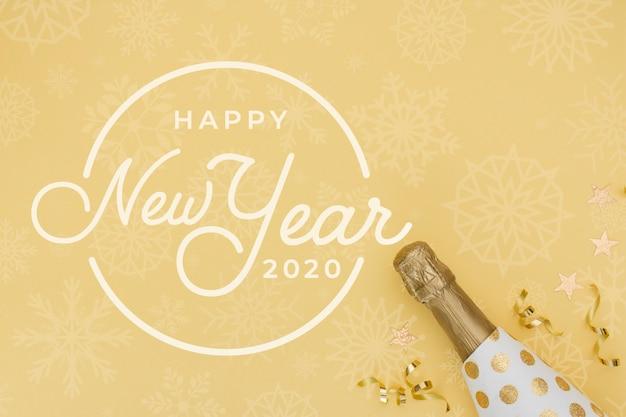 Nuovo anno 2020 con bottiglia d'oro di champagne Psd Gratuite