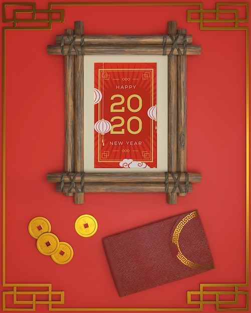 New year dated frame and ornaments beside Free Psd