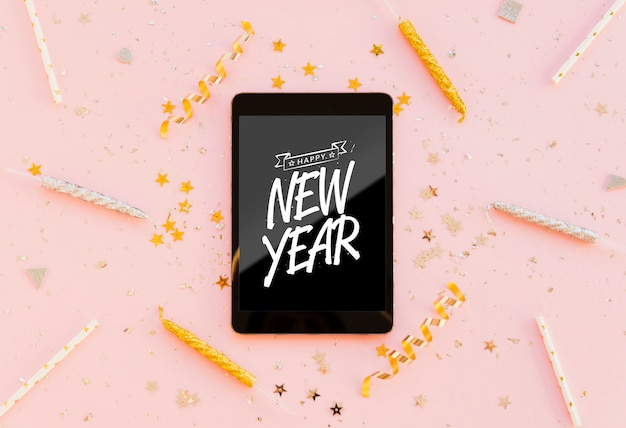 New year minimalist lettering on black tablet Free Psd