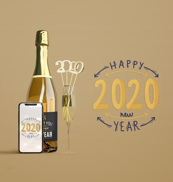 Mock-up di capodanno con champagne Psd Gratuite