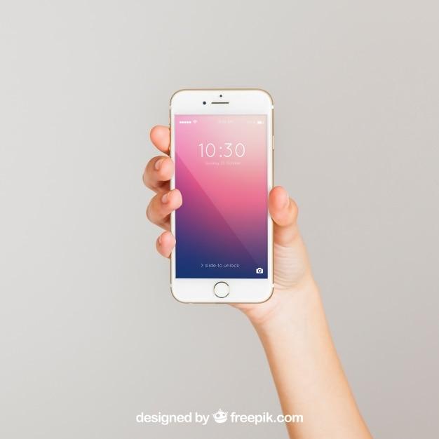 スマートフォンを示す手のモックアップの概念 無料 Psd