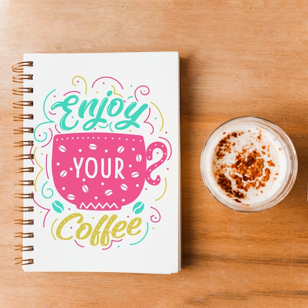 Notebook cover mockup with coffee concept Free Psd