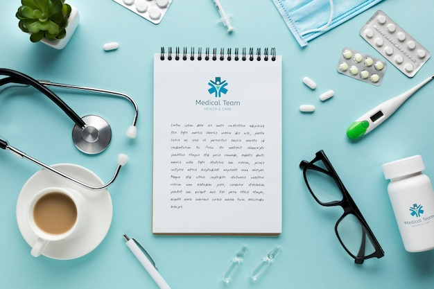 Notebook on medical desk with cup of coffee Free Psd