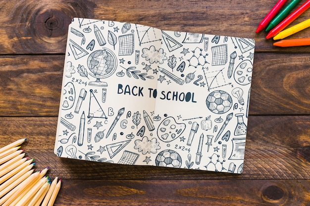 Notebook mockup with back to school concept Free Psd