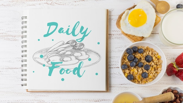 Notebook mockup with breakfast concept Free Psd