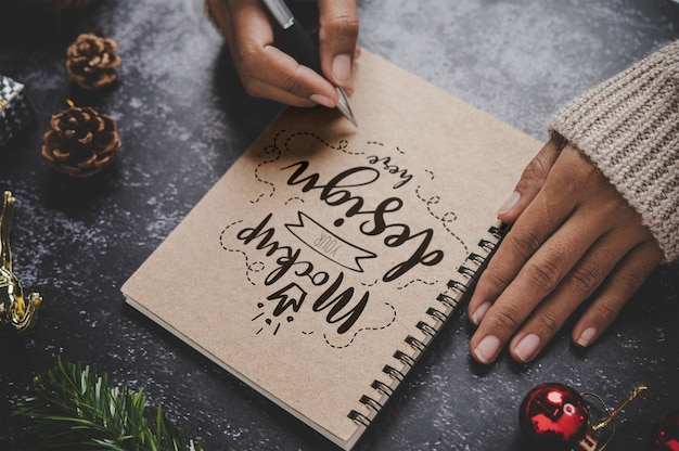 Notebook mockup with christmas decoration Free Psd