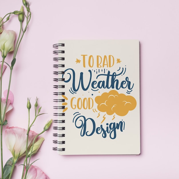 Notebook mockup with floral concept Free Psd