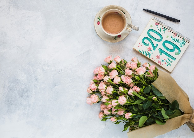 Notebook mockup with floral decoration for wedding or quote Free Psd