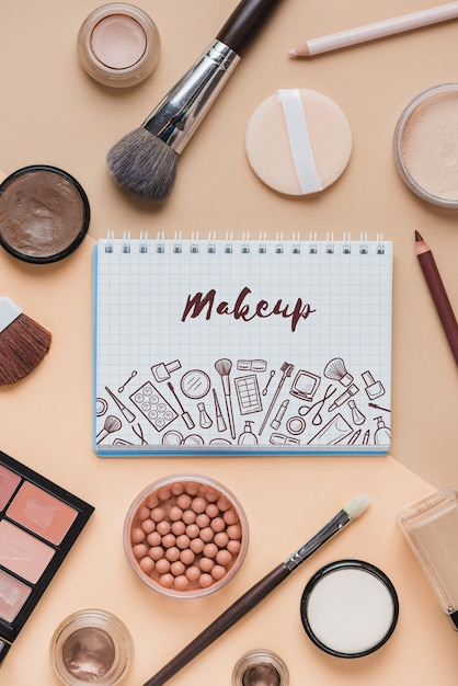 Notebook mockup with makeup concept Free Psd