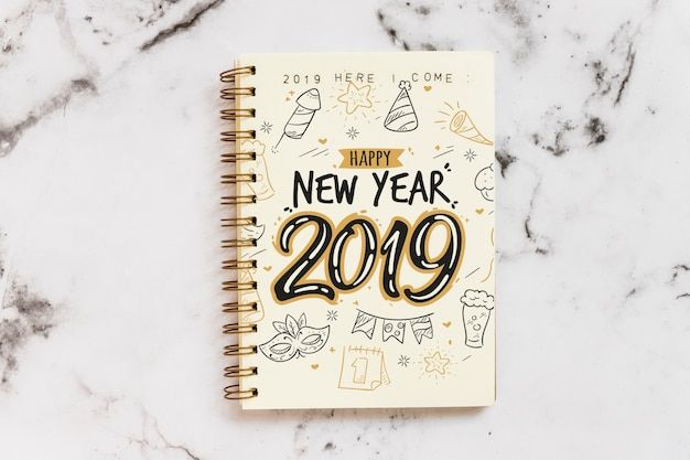 Notebook mockup with new year concept Free Psd