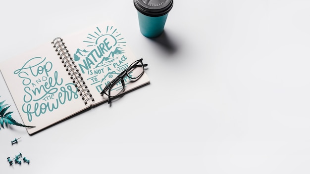 Notebook mockup with take away coffee cup Free Psd