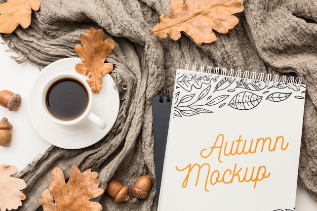 Notebook with cup of coffee on table Free Psd