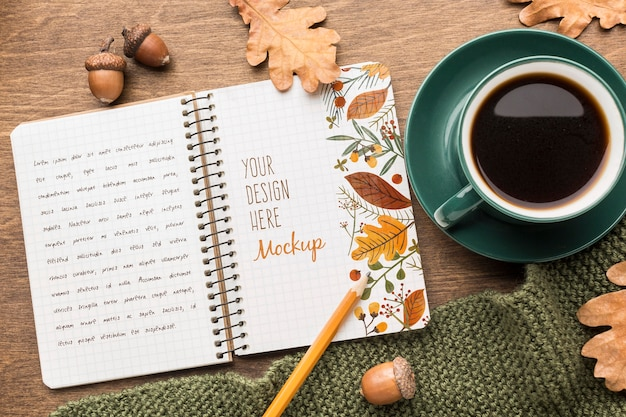 Notebook with cup of coffee Free Psd