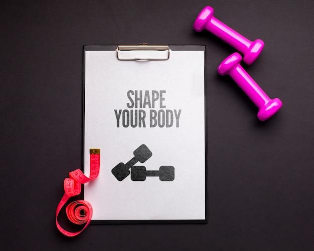 Notebook con pesi e misuratore di fitness Psd Gratuite