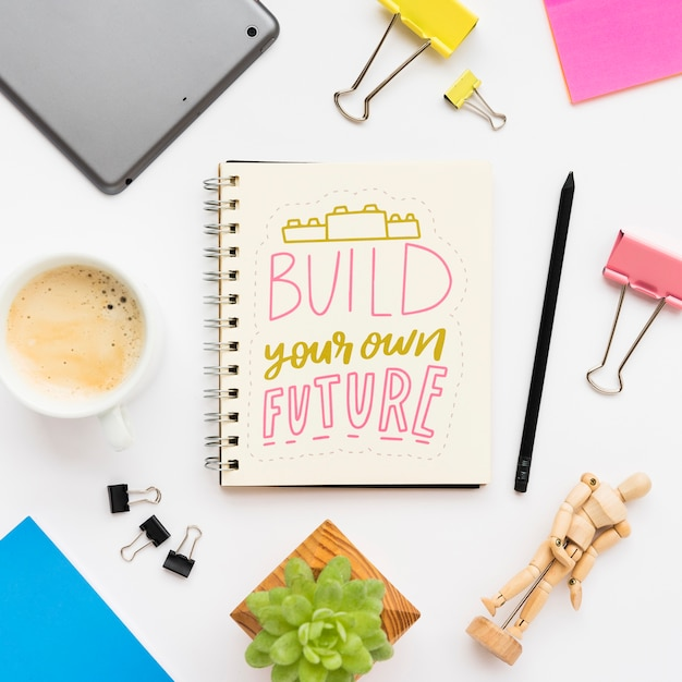 Notebook with inspirational message Free Psd
