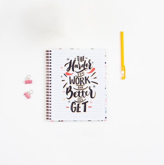 Notebook with inspirational quotation Free Psd