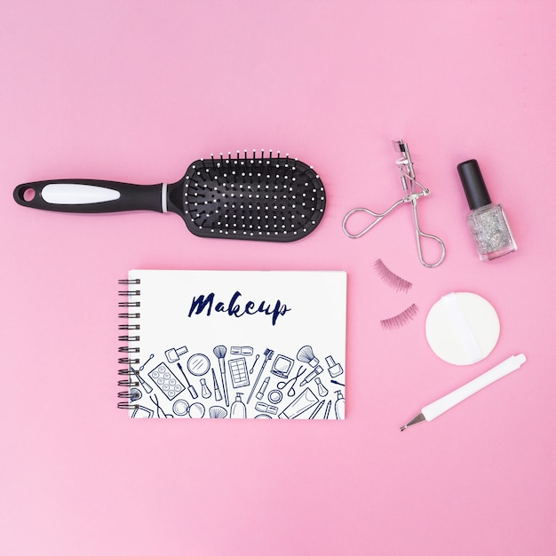 Notepad mockup with beauty concept Free Psd