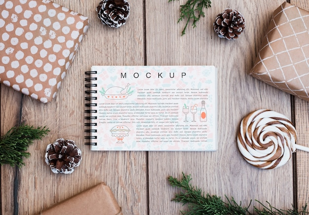 Notepad mockup with christmas concept Free Psd