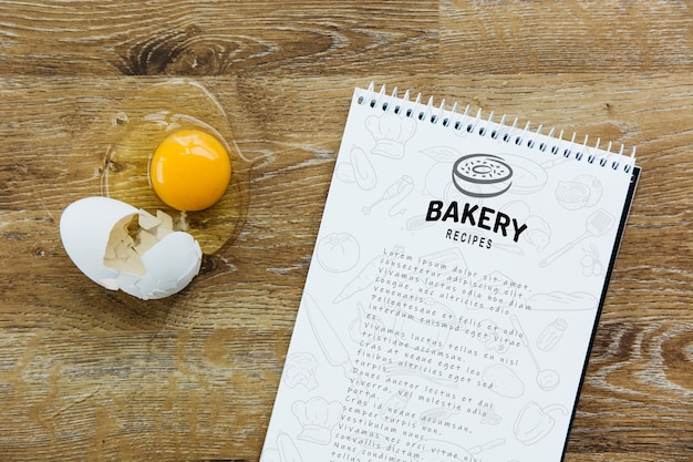 Notepad mockup with kitchen and recipe concept Free Psd