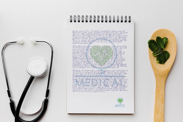 Notepad with mint leaves top view Free Psd