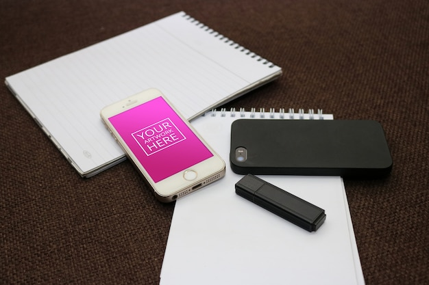 Notepad with smartphone and flash drive Free Psd