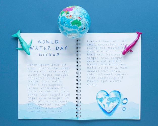 Ocean day notebook mock-up and earth Free Psd