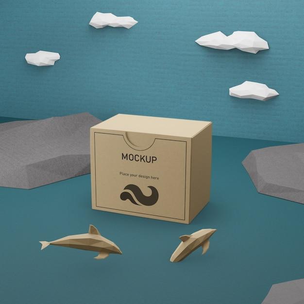 Океанский день бумажная коробка с концепцией дельфинов Бесплатные Psd