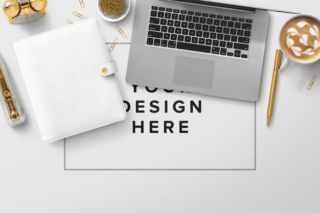 Office desktop mockup with a laptop Premium Psd