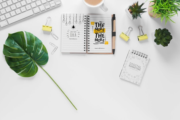 Office plants keyboard and notebook mock-up Free Psd