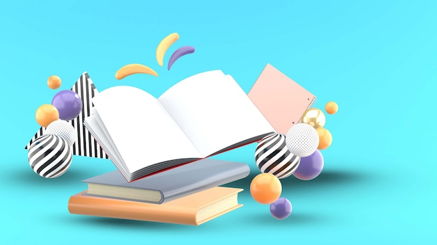 Open book and notebook surrounded by colorful ball on a blue Premium Psd