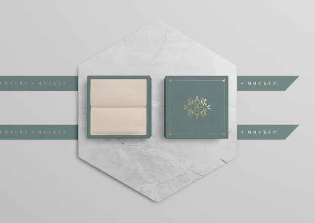 Opened jewelry box on marble with golden symbol Free Psd