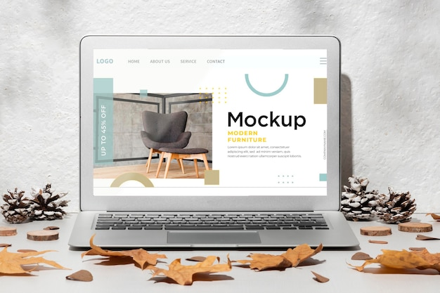 Opened laptop mockup on the table surrounded by autumn decor Free Psd