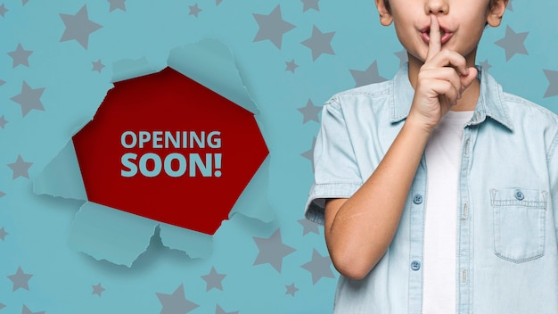 Opening soon! young cute boy mock-up Free Psd