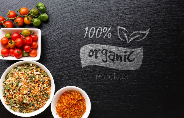 Organic mock-up with spices and tomatoes Free Psd