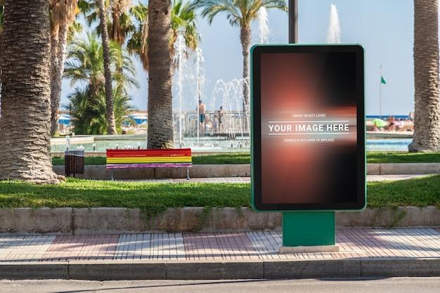 Outdoor billboard advertisement in seaside resort city mockup Premium Psd