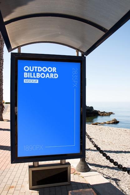 Outdoor billboard close to the beach Premium Psd