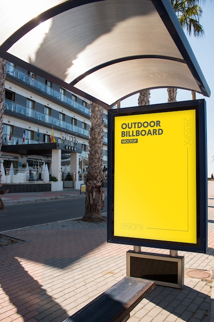 Outdoor billboard close to the beach Premium Psd