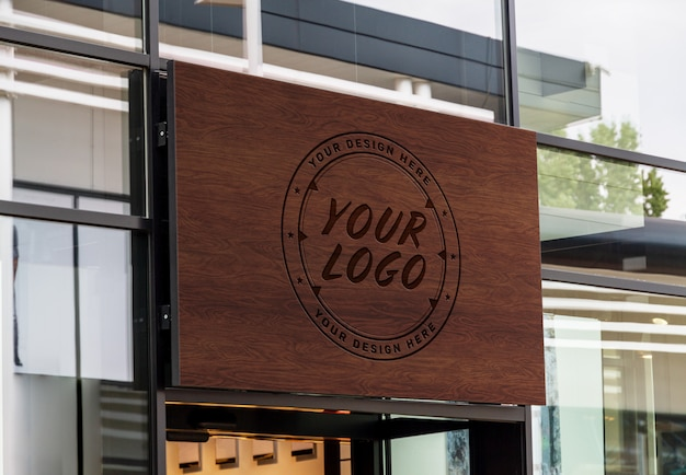 Outdoor engraved wood sign on shop front window mockup Premium Psd