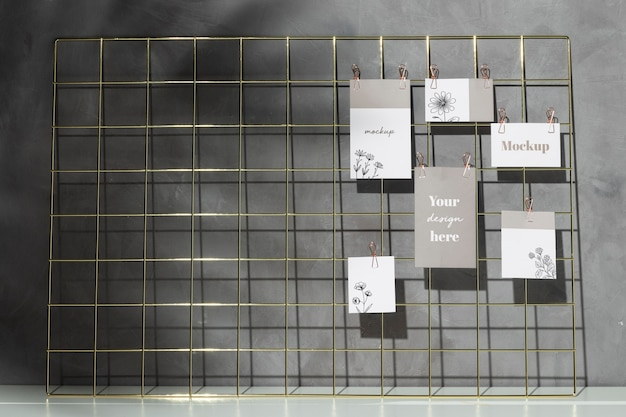 Pack of cards hanging on grid memo board with clips Premium Psd
