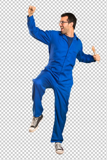 Painter man enjoy dancing while listening to music at a party Premium Psd