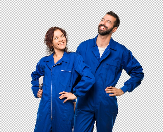Painters posing with arms at hip and laughing Premium Psd