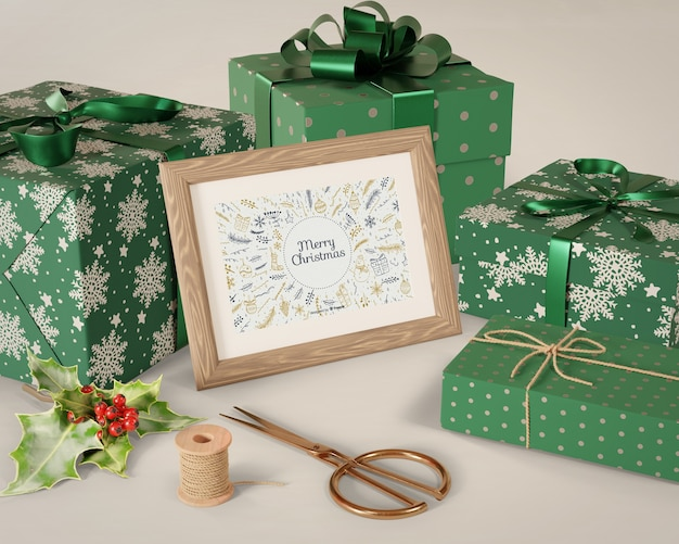 Painting on table beside wrapped gifts Free Psd