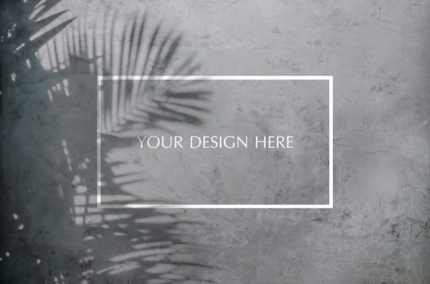 Palm leaf shadow on the cracked concrete wall Premium Psd
