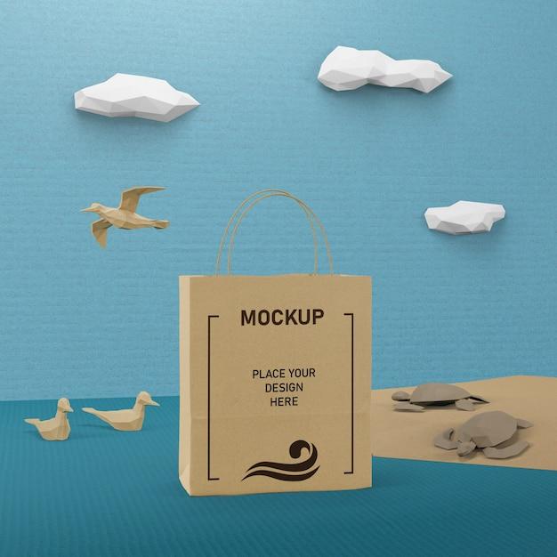 モックアップで紙袋と海の生活の概念 無料 Psd