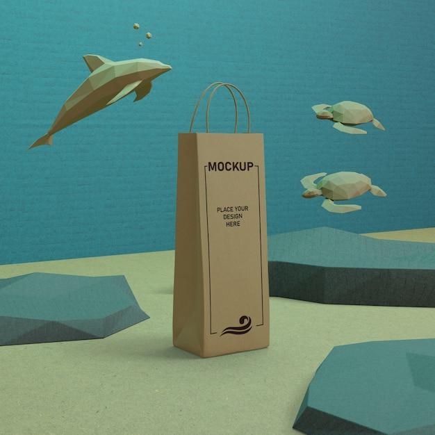 モックアップで水中の紙袋と海の生物 無料 Psd
