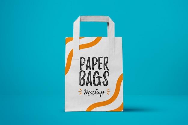 Paper bag on blue background mock up Premium Psd