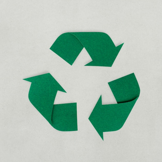 Paper craft design of recycle icon Free Psd