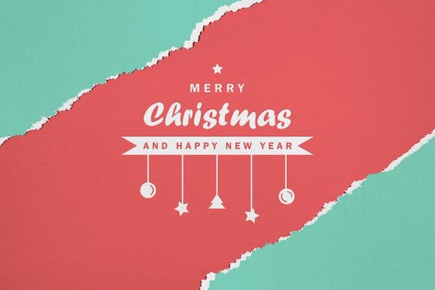 紙のメリークリスマスと新年あけましておめでとうございますのモックアップ Premium Psd